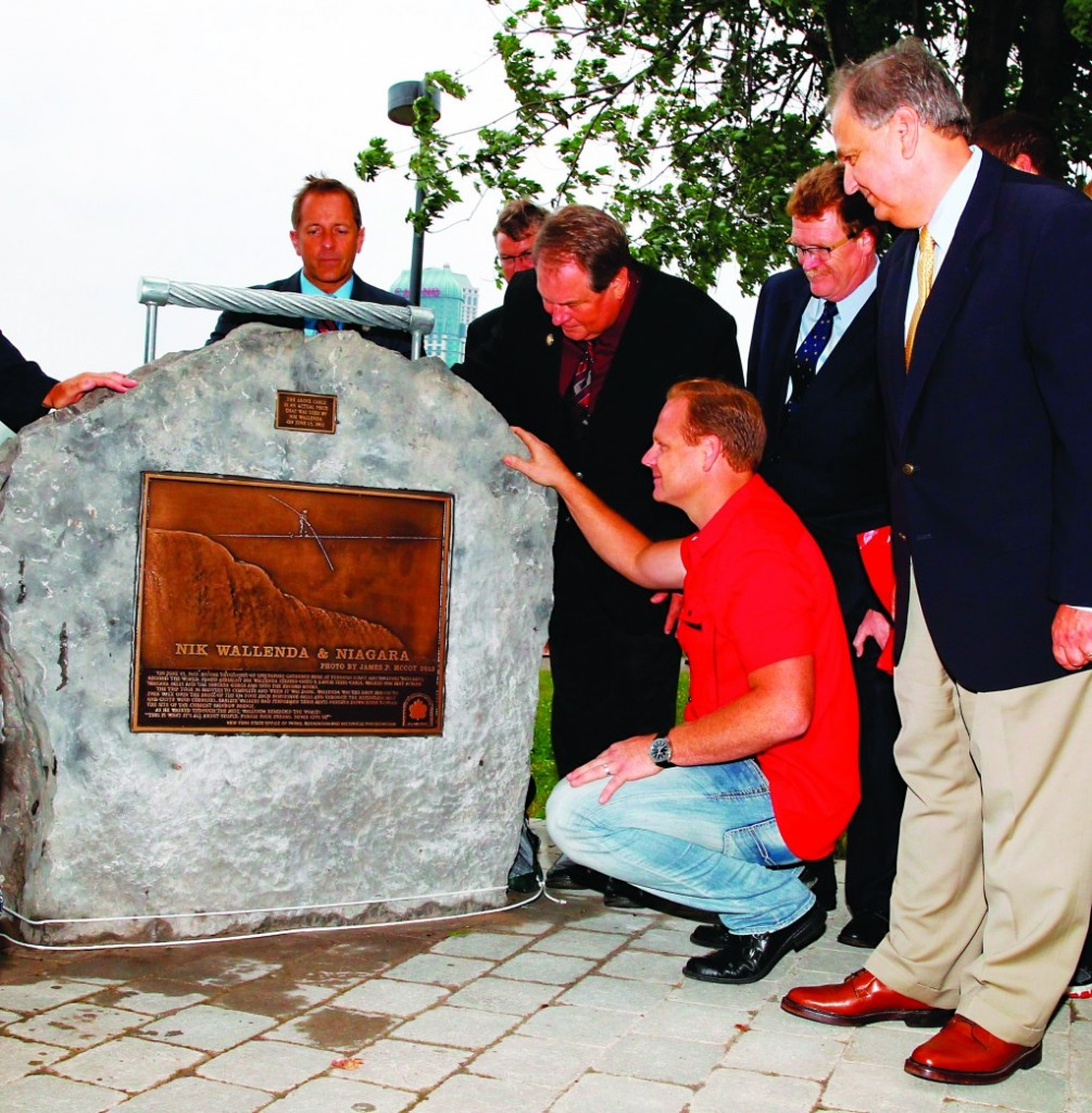 Wallenda, in red shirt, checks out a monument unveiled on Monday at Niagara Falls State Park. (AP Photo/The Buffalo News, John Hickey)