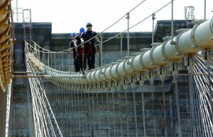 Workers on Tuesday walk off the top of the Brooklyn Bridge after removing the white flag.