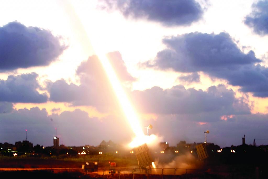 An Iron Dome Missile Defense battery set up near Ashdod fires an interceptor.  (Miriam Alster/Flash90)