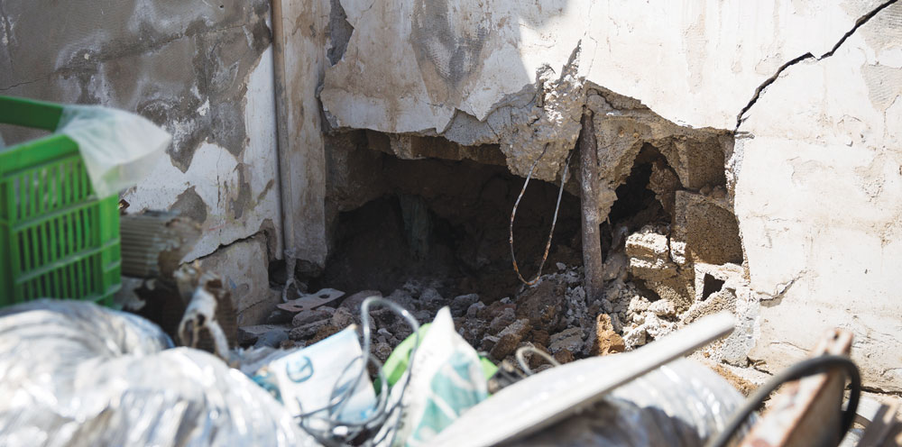 A wall directly hit by a rocket from Gaza, in a back yard in the southern Israeli town of Netivot, on Thursday, July 10. (Hadas Parush/Flash90)
