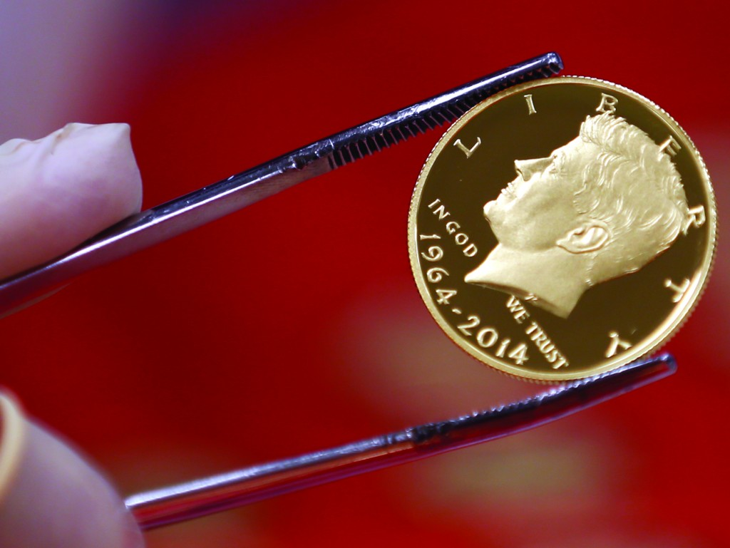 A newly-stamped JFK gold coin on Tuesday at the U.S. Mint at West Point. (AP Photo)