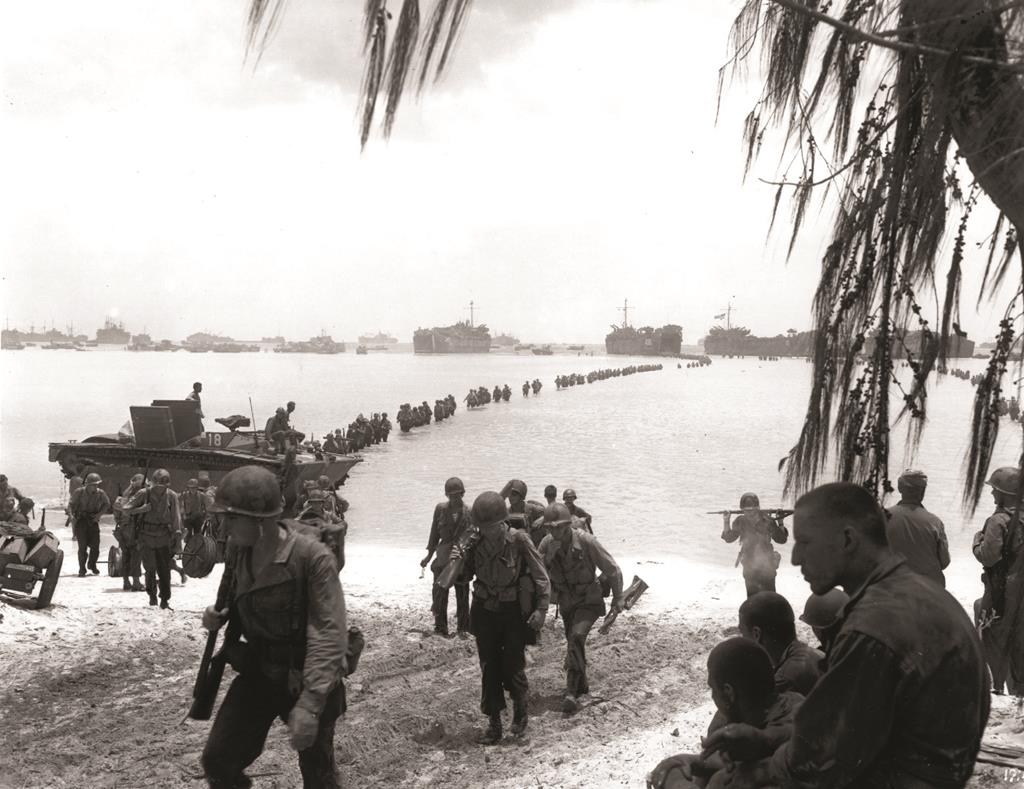 U.S. Army troops making an amphibious landing on the coral reef at Saipan beach, in July of 1944. (AP Photo)