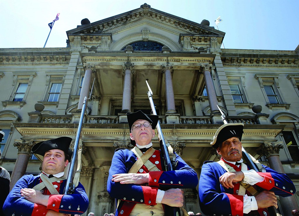 Re-enactor soldiers last week Tuesday stand in front of the Statehouse in Trenton as New Jersey celebrates 350 years of history. (AP Photo/Mel Evans)