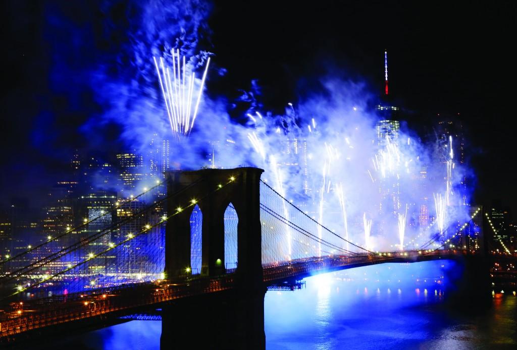 Fourth of July fireworks on Friday light up the sky above the Brooklyn Bridge. (AP Photo/Mark Lennihan)