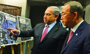 Israeli Prime Minister Binyamin Netanyahu (L) showing aerial photographs of Hamas terror sites in civilian areas to U.N. Secretary General Ban Ki-Moon as they met in Tel Aviv on Tuesday. (Haim Zach/GPO/Flash90)
