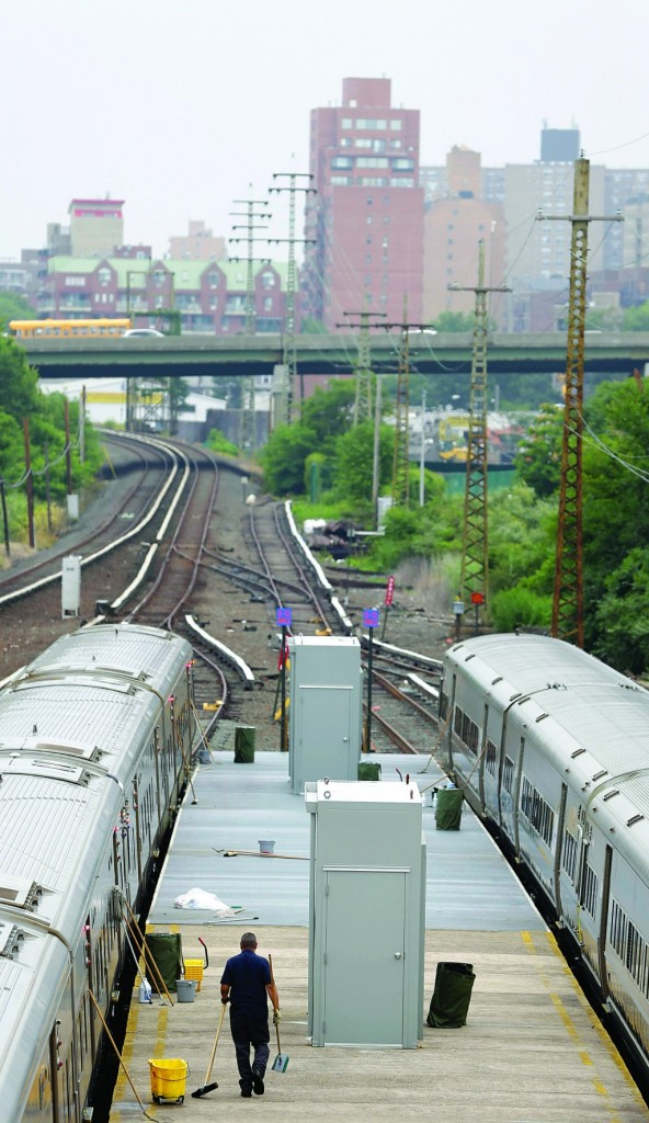 LIRR trains are cleaned Tuesday at a stop in Queens. (AP Photo/Seth Wenig)