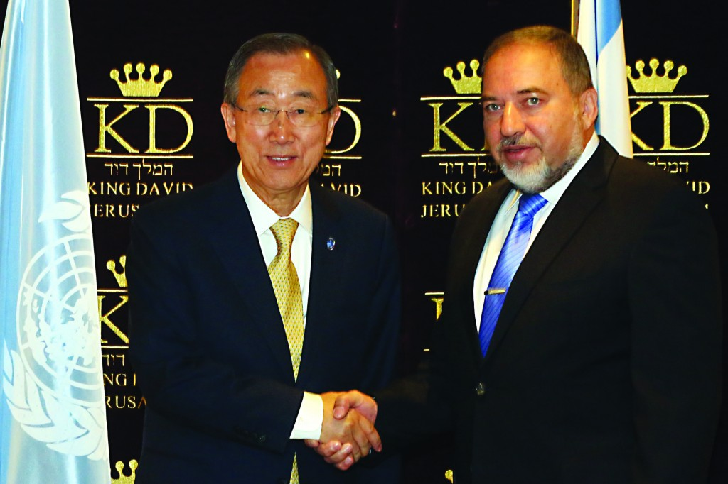 United Nations Secretary-General Ban Ki-moon (L) shakes hands with Israel's Foreign Minister Avigdor Lieberman during a joint press conference on Wednesday. (Yossi Zamir/Flash90)