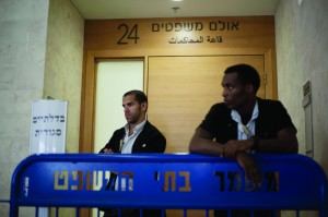 Israeli court security officers stand guard at the entrance to a courtroom in Petach Tikva, Israel, Sunday