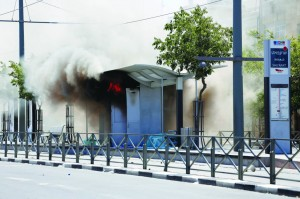 A lightrail station set on fire by Palestinians rioting in the East Yerushalayim neighborhood of Shuafat on Wednesday. (Sliman Khader/FLASH90)