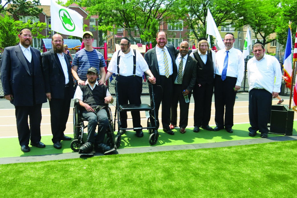 Councilman David Greenfield, Parks Commissioner Kevin Jeffrey and State Senator Simcha Felder celebrate the grand opening of a new park on 48th Street and 18th Avenue on Tuesday.