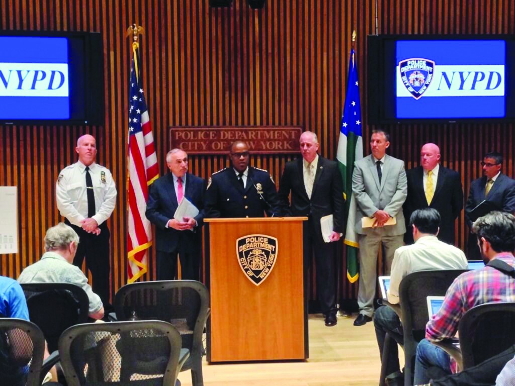 NYPD Chief of Department Phillip Banks, with Commissioner William Bratton at his left, on Monday announces a surge in police patrols due to a spike in crime. (NYPD)