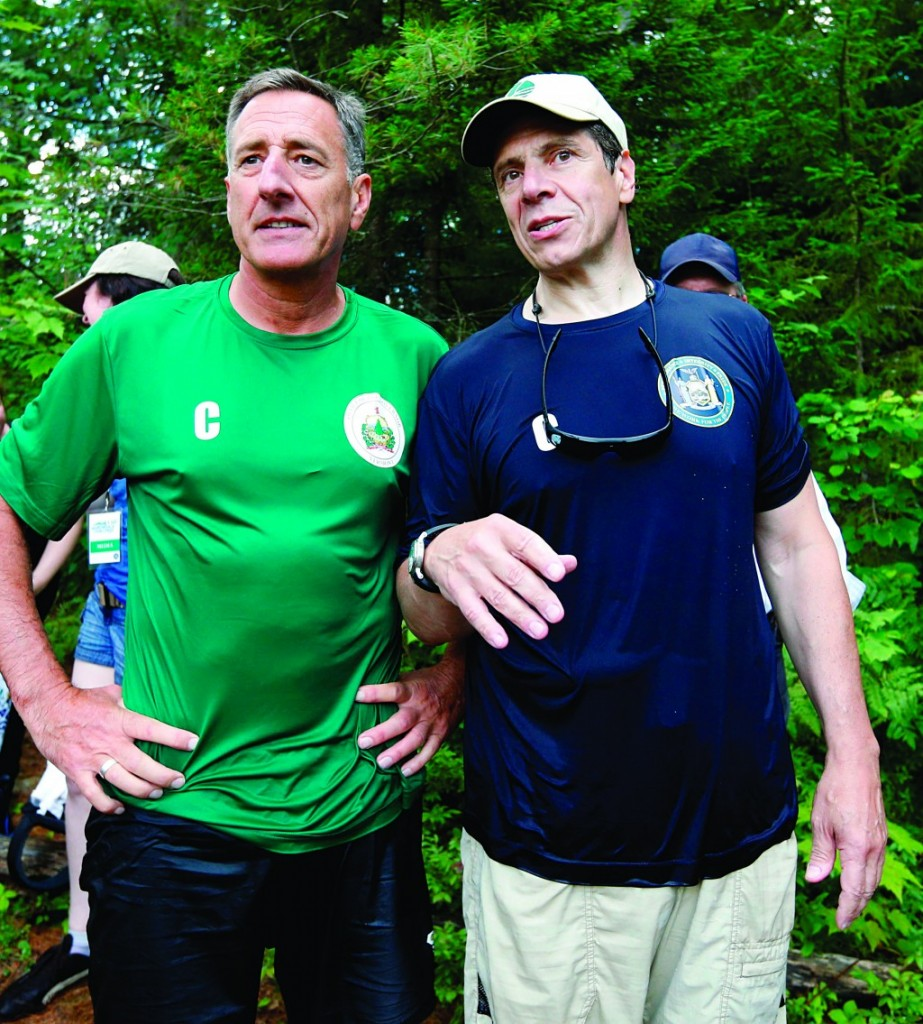 Vermont Gov. Peter Shumlin (L) and Gov. Andrew Cuomo on Sunday after they competed in a rafting competition. (AP Photo/Mike Groll)