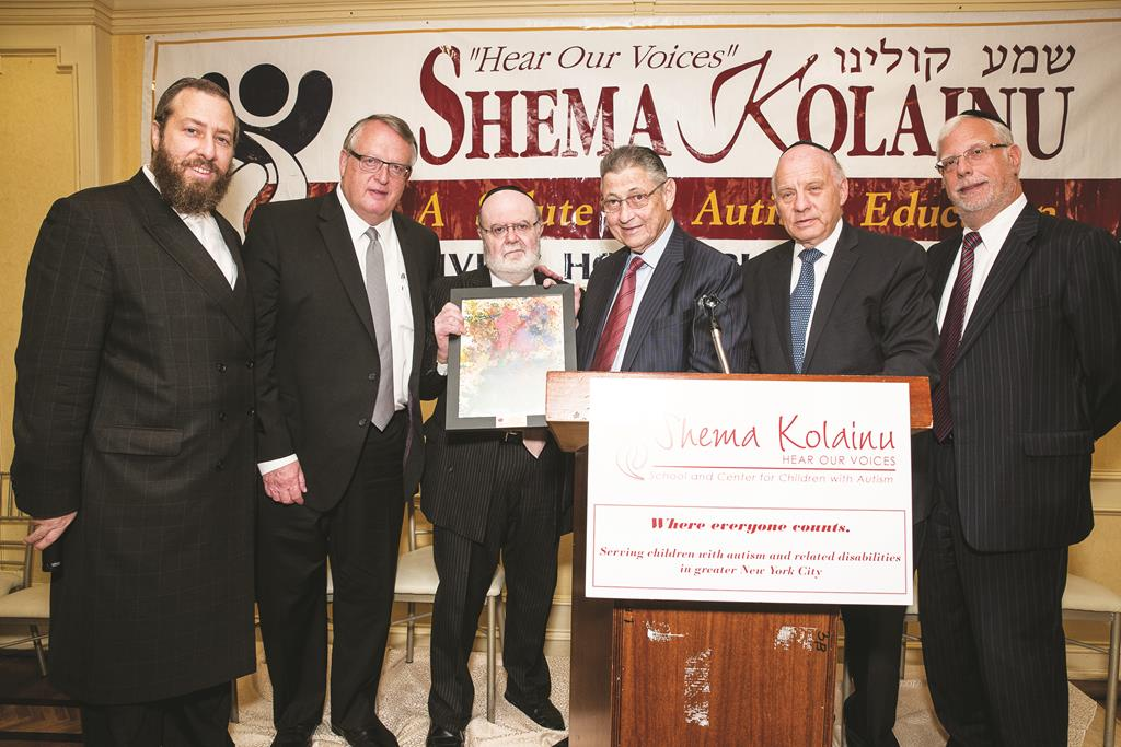 Assembly Speaker Sheldon Silver on Tuesday was honored at the Shema Kolainu legislative breakfast for his role in the historic agreement in the placement of special needs children in private schools. (L-R) Ezra Friedlander, Peter Rebenwurzel, Joshua Weinstein, Menachem Lubinsky, Speaker Silver and Milton Weinstock.