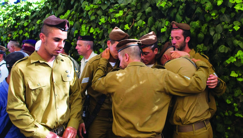 "Israeli soldiers mourn during the levayah of their comrade Moshe Malko, Hy""d, at the Mount Herzl cemetery in Yerushalayim on Monday. (REUTERS/Ronen Zvulun)"