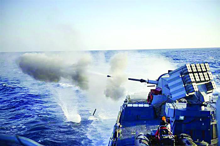 Naval ships firing at the Gaza coast.
