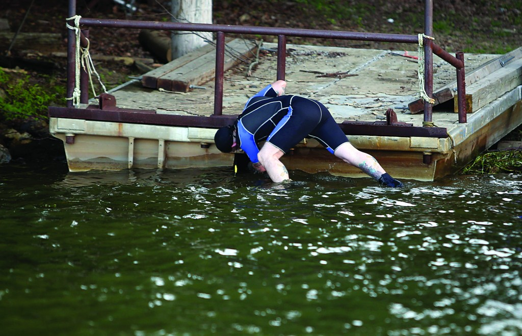 Gerald Andrejcak, an animal-rights activist, on Sunday searches for a large snake in Lake Hopatcong near Jefferson, NJ. (AP Photo/The New Jersey Herald, Daniel Freel)