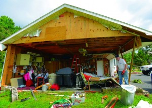 David Wilson on Wednesday looks over his damaged property in Deerfield, N.Y. (AP Photo/Observer-Dispatch, Mark DiOrio)