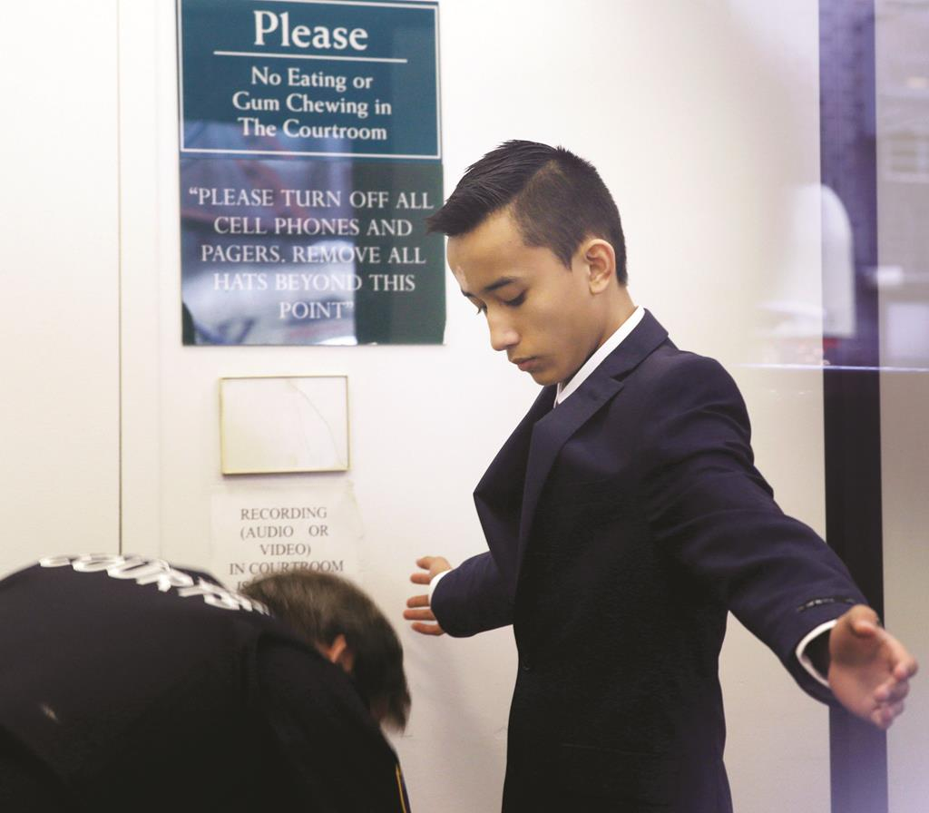 Justin Casquejo passes through security at a New York City courthouse when he was arrested in April. (AP Photo/Seth Wenig)