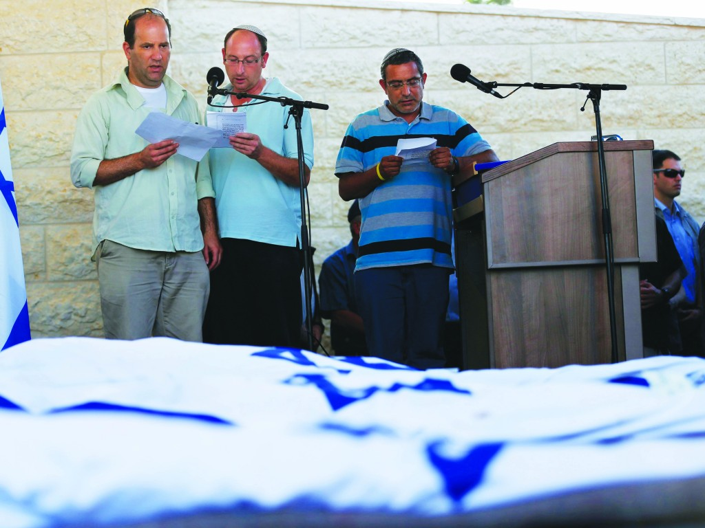 (L-R) Avi Frankel, Ofir Shaar and Ori Yifrach, fathers of the three boys who were  murdered, at the levayah Tuesday.