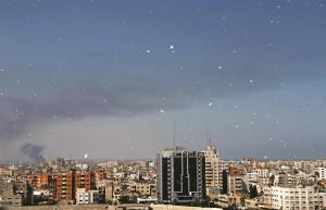 Warning leaflets fall from an Israeli plane over Gaza City, Wednesday. (AP Photo/Hatem Moussa)