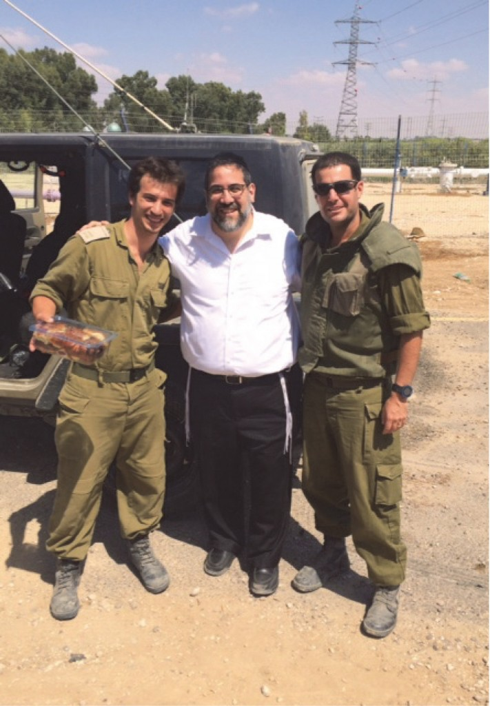 Expressing gratitude, Rabbi Gedaliah Oppen went to Israel for three days on a hakaras hatov mission distributing freshly baked cookies, cake and drink to soldiers of the IDF. Here Rabbi Oppen poses with IDF troops on the border of Gaza.
