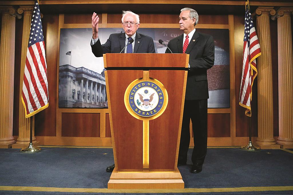 Senate Veterans' Affairs Committee Chairman Bernie Sanders (I-VT) (L) and House Veterans' Affairs Committee Chairman Jeff Miller (R-FL) announce bipartisan legislation to address problems in the VA health-care system, at the U.S. Capitol in Washington'  (REUTERS/Jonathan Ernst)