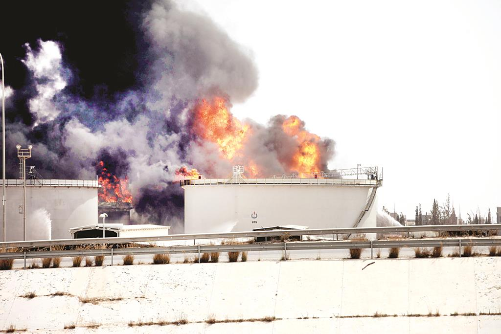 A general view shows fire burning at a fuel depot near the airport road in Tripoli Tuesday. (REUTERS/Hani Amara)