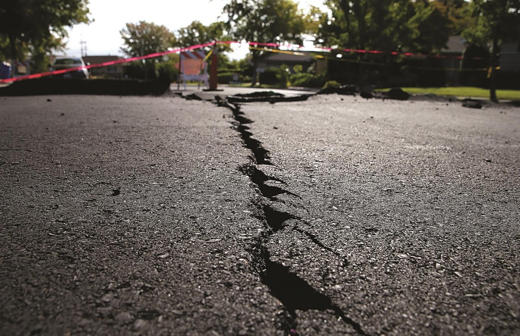 A crack runs down the center of an earthquake-damaged street on Wednesday in Napa, California. (Justin Sullivan/Getty Images)