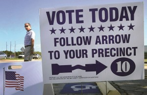 A voter leaves a precinct in Panama City Beach, Fla. on Tuesday. (AP Photo/The News Herald, Fla., Andrew Wardlow)
