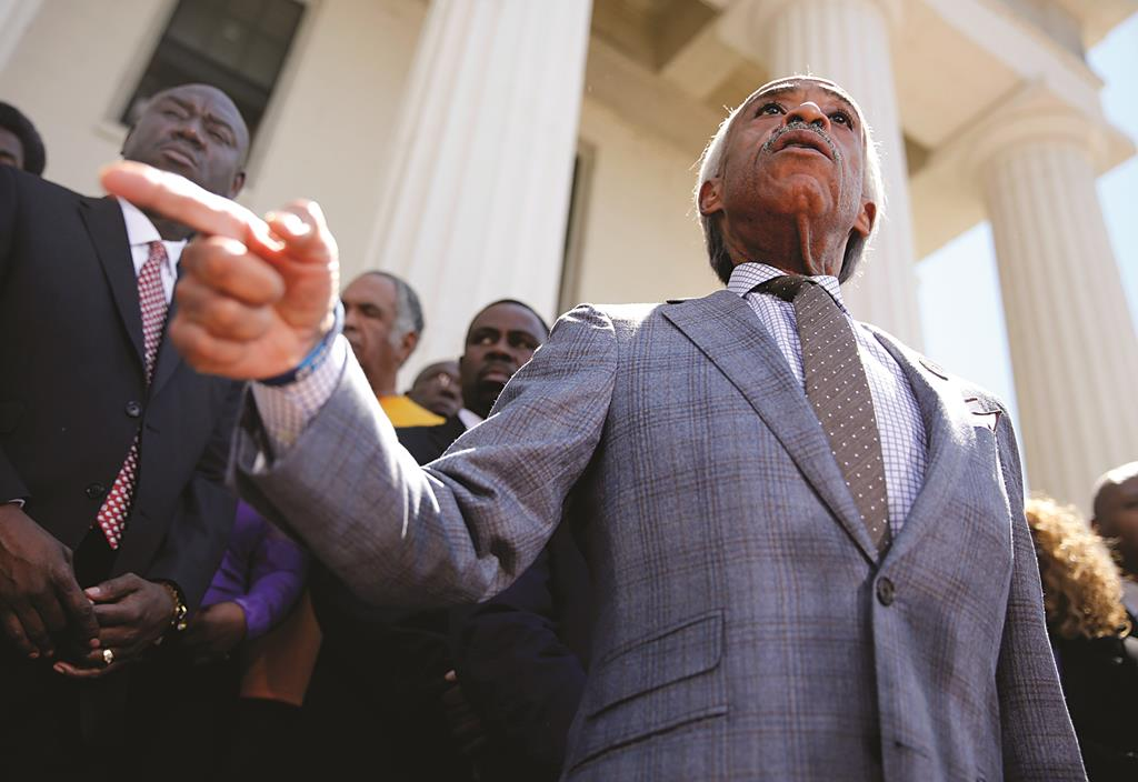 Al Sharpton speaks during a news conference outside the Old Courthouse Tuesday, in St. Louis. (AP Photo/Jeff Roberson)