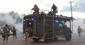 Tactical officers fire tear gas on Monday,  in Ferguson, Mo.  (AP Photo/St. Louis Post-Dispatch, Robert Cohen)
