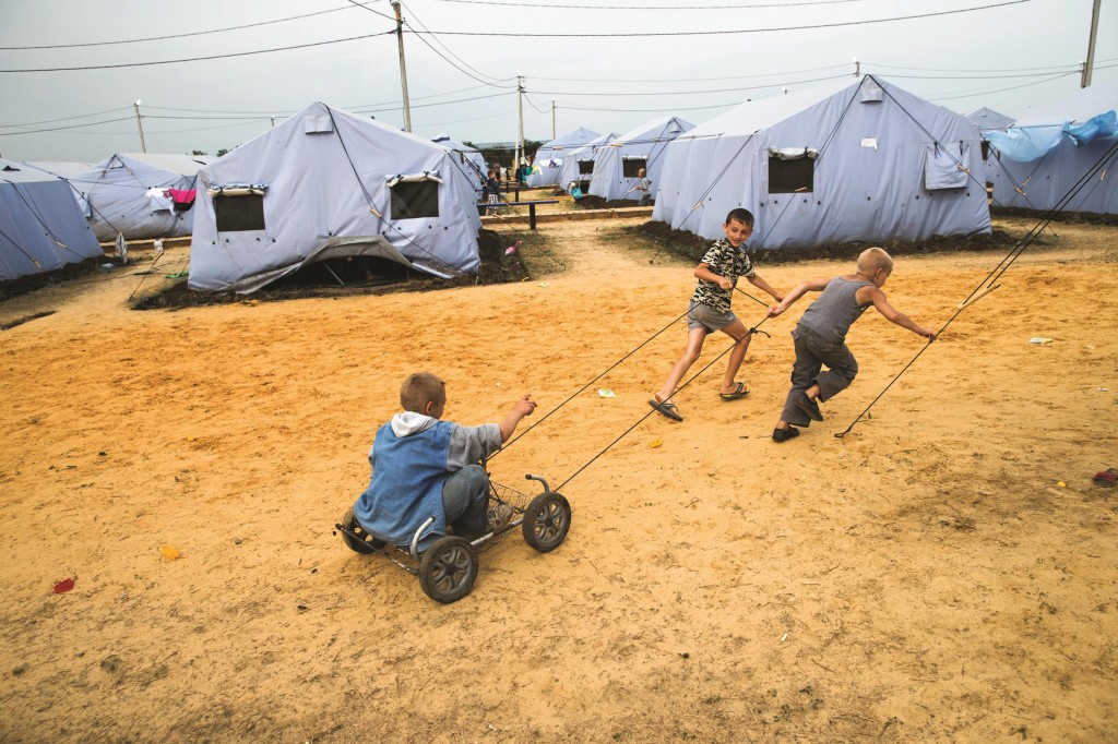 Boys play in a refugee camp set up by the Russian Emergencies Ministry for people displaced by fighting in Ukraine, about 6 miles from the Russia-Ukraine border, near Donetsk, Rostov-on-Don region, Russia, Monday. (AP Photo/Pavel Golovkin)