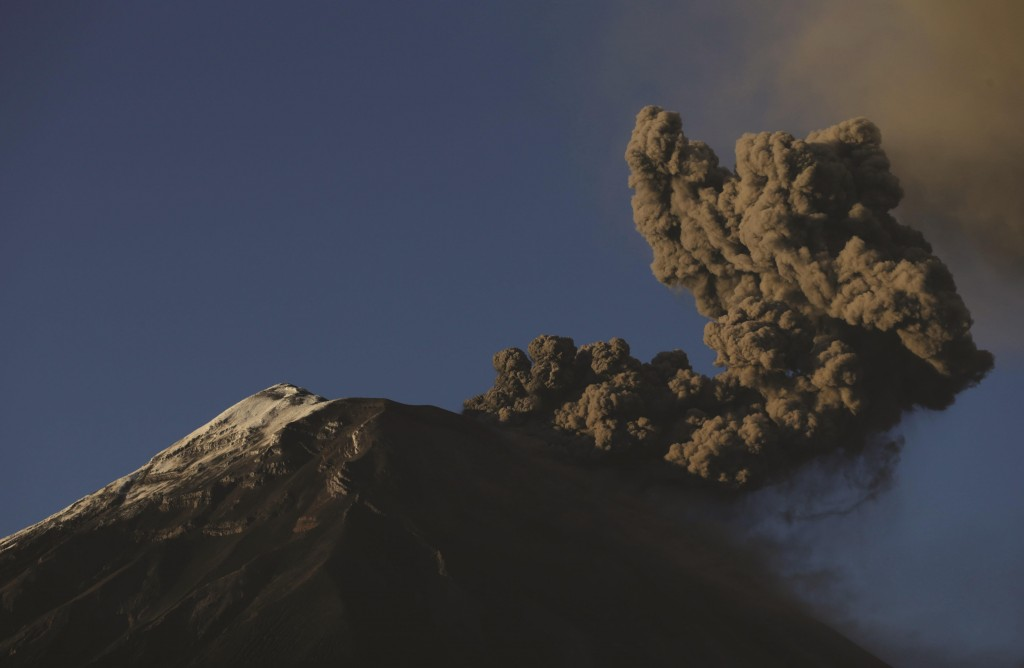 The Tungurahua volcano spews a column of ash during an eruption seen from Banos, Ecuador, Sunday. The volcano entered an eruptive phase in 1999 and continues to this day.  (AP Photo/Dolores Ochoa)