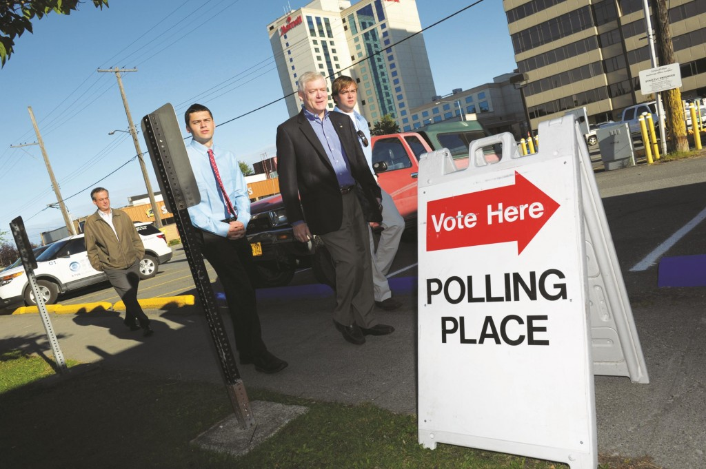Alaska Lt. Gov. Mead Treadwell, center, enters his voting place in downtown Anchorage, Alaksa, Tuesday, to vote in the state's primary election.  (AP Photo/Michael Dinneen)