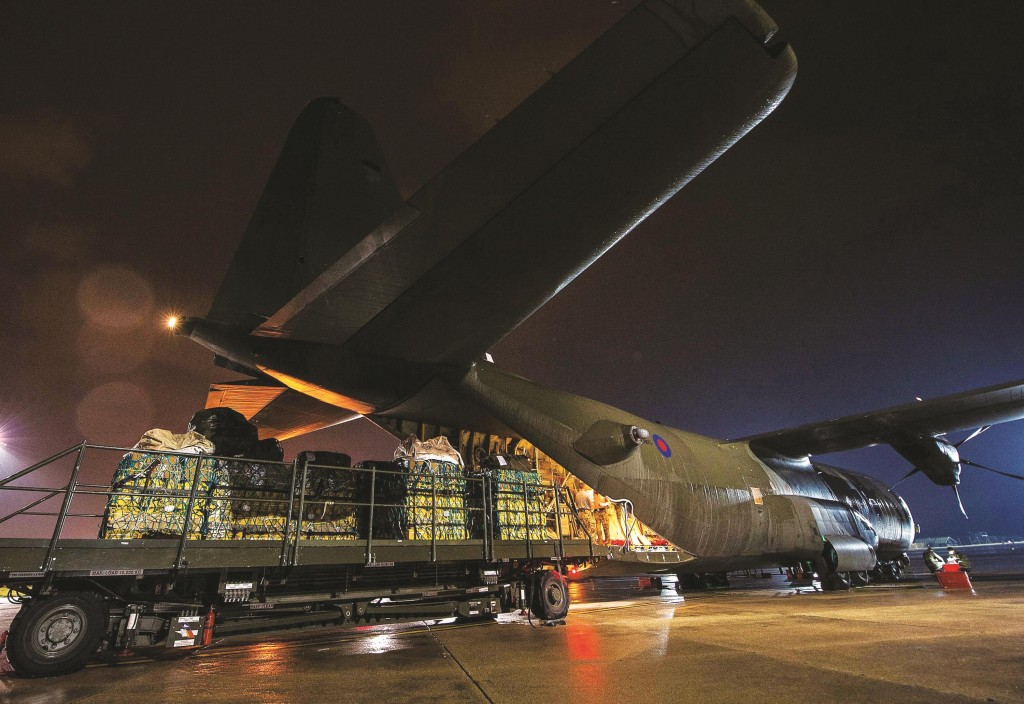 In this British Ministry of Defense recent image, humanitarian aid being loaded onto a RAF Hercules C130 at RAF Brize Norton, England en-route for Iraq, as the West tries to counter the threat from Islamic State (IS) terrorists in the troubled country.  (AP Photo/Steve Lympany/MoD Crown Copyright)