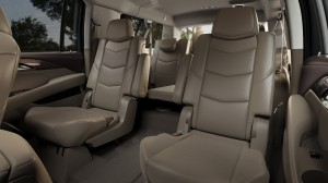 The 2015 Escalade interior features cut-and-sewn and wrapped materials, with wood trim options chosen for elegance and authenticity. (General Motors/MCT)