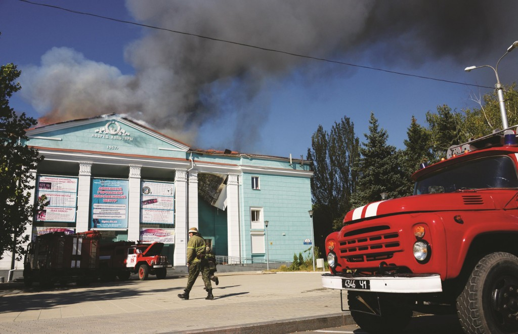 The House of Culture burns after shelling in the town of Donetsk, eastern Ukraine, Wednesday. (AP Photo/Mstislav Chernov)