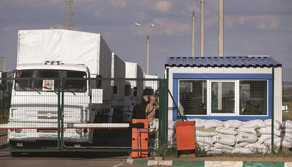 First trucks of the Russian aid convoy stand in the Russian inspection zone inside a border control point with Ukraine in the Russian town of Donetsk, Rostov-on-Don region, Russia, Thursday. (AP Photo/Sergei Grits)