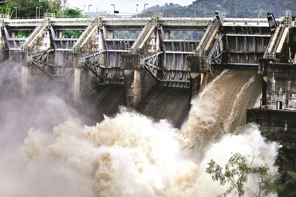 Water rushes through an open bay at the Carraizo Dam to release water left by the passing tropical storm in Trujillo Alto, Puerto Rico, on Saturday. (AP Photo/Ricardo Arduengo)