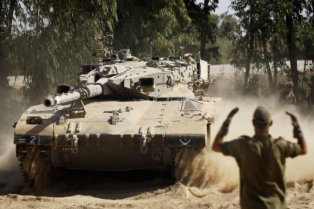 IDF tanks redeploy in South Israel along the border with Gaza, as Israeli forces prepare to clear the area, on Wednesday.  (Miriam Alster/Flash90)