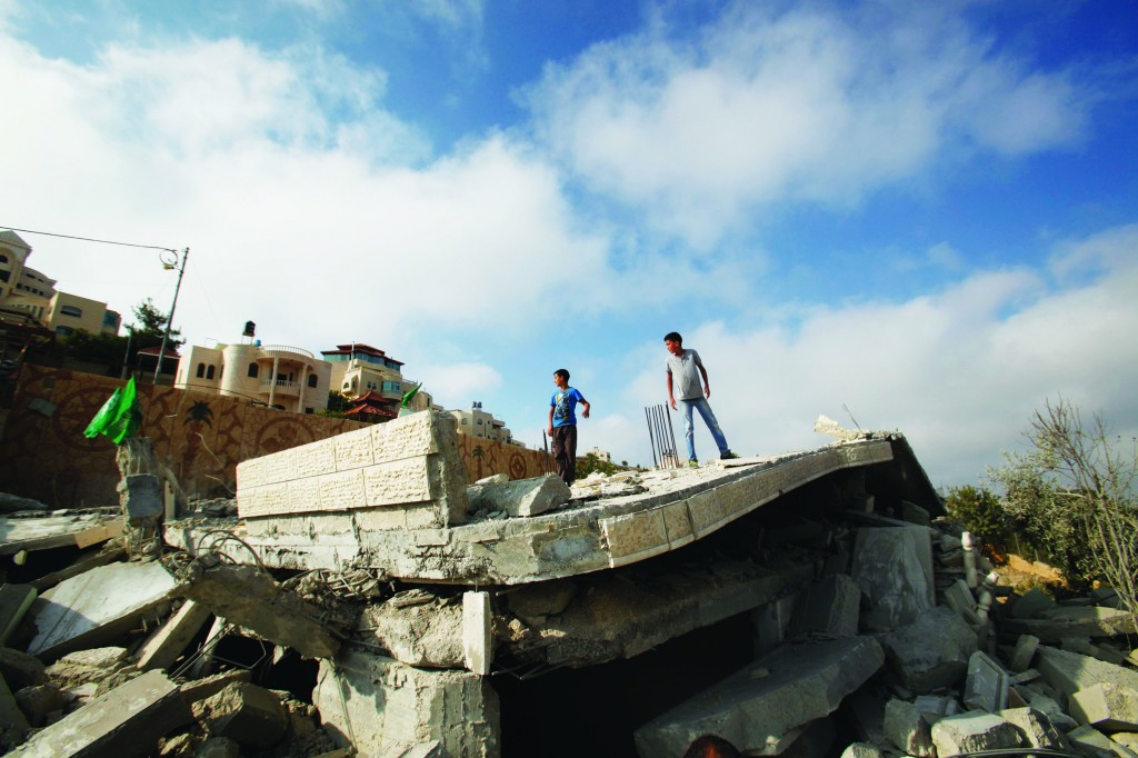 Remnants of the house of Hussam Kawasma. (AP Photo/Nasser Shiyoukhi)