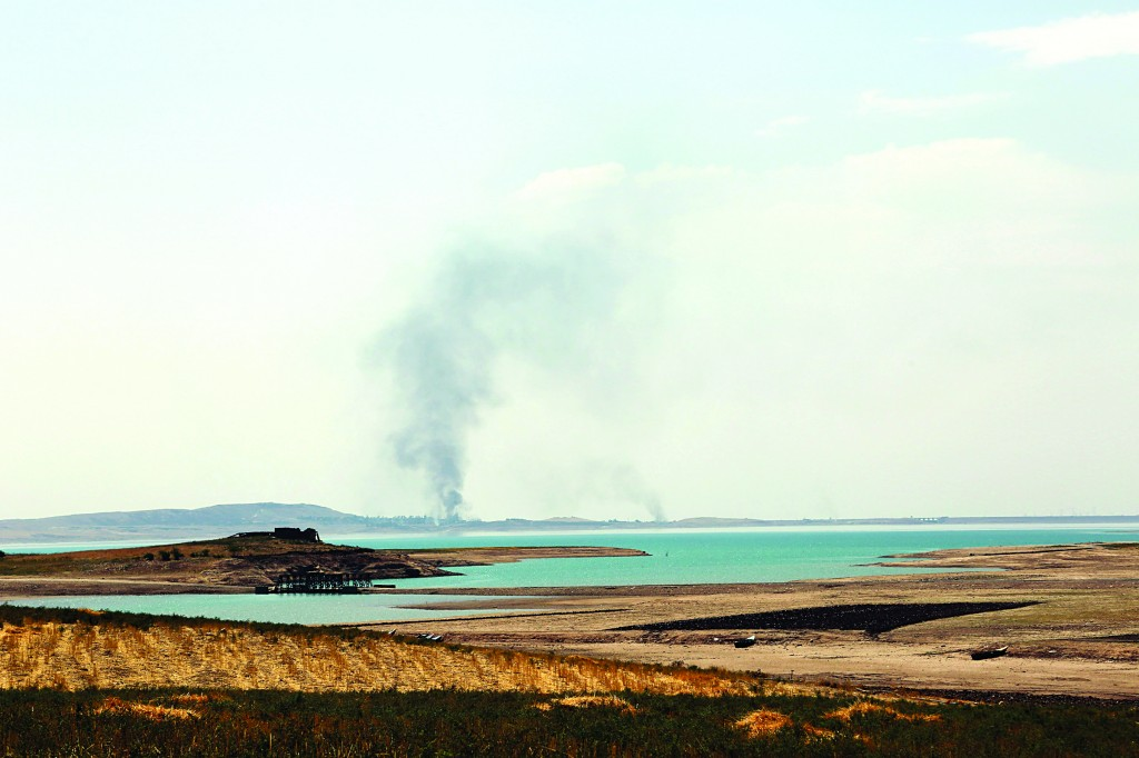 Smoke rises during airstrikes targeting Islamic State fighters at the Mosul Dam outside Mosul, Iraq, Monday. (AP Photo/Khalid Mohammed)
