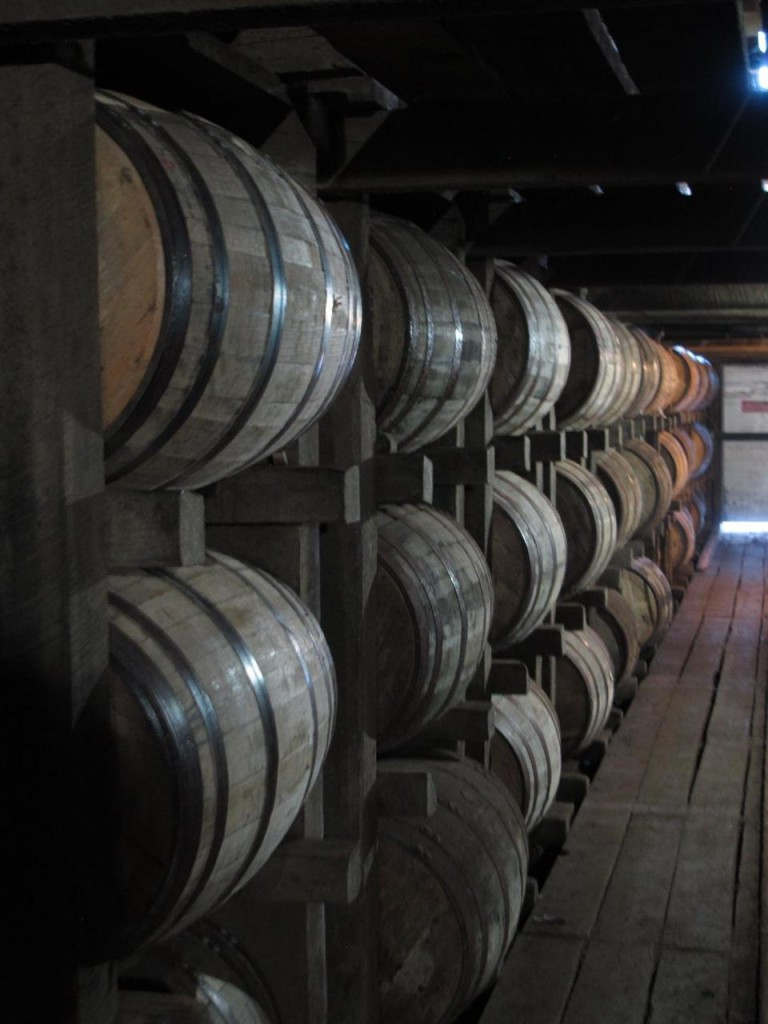 In this July 24, 2014 photo, bourbon supplies age in barrels at the Jim Beam distillery in Clermont, Ky. Kentucky bourbon makers have stashed away their largest stockpiles in more than a generation due to resurgent demand for the venerable brown spirit.   (AP Photo/Bruce Schreiner)