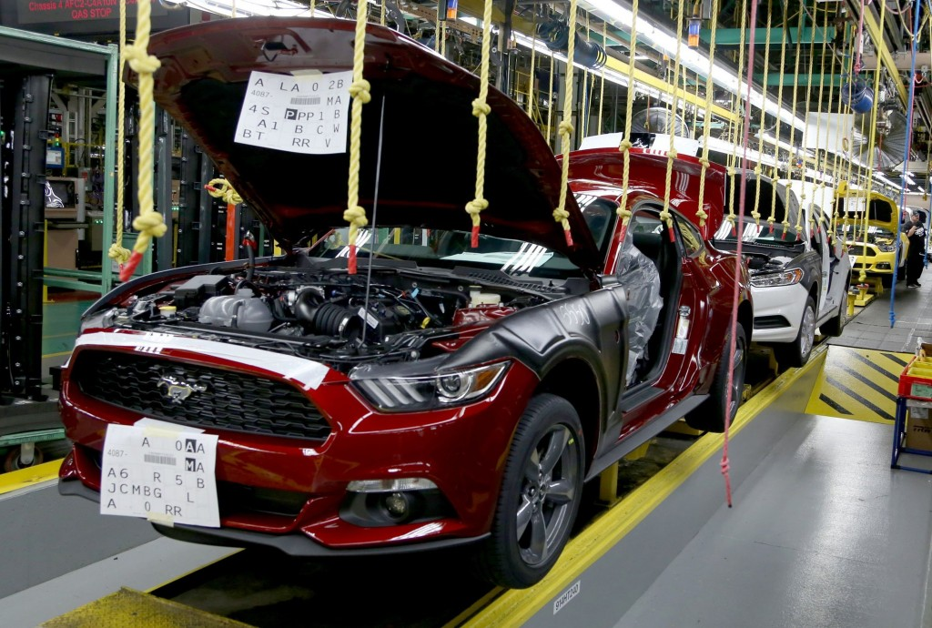 2015 Ford Mustangs sit on the assembly line inside the Ford Flat Rock Assembly Plant in Flat Rock, Mich., on Thursday, Aug. 28, 2014. (Eric Seals/Detroit Free Press/MCT)