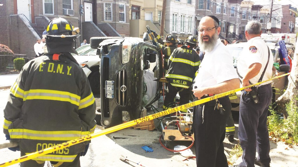 Overturned car on its side in Boro Park Wednesday.
