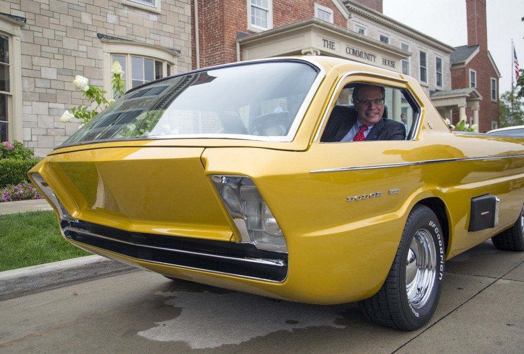 "Mark Gessler, President of the Historic Vehicle Association (HVA), poses with a custom 1967 Dodge Deora before unveiling the ""National Historic Vehicle Register Act of 2014"" to document and recognize historically important vehicles, on Tuesday, August 12, 2014, near Detroit. The Deora became one of the most popular Hot Wheels cars to ever sell. (Kathleen Galligan/Detroit Free Press/MCT)"