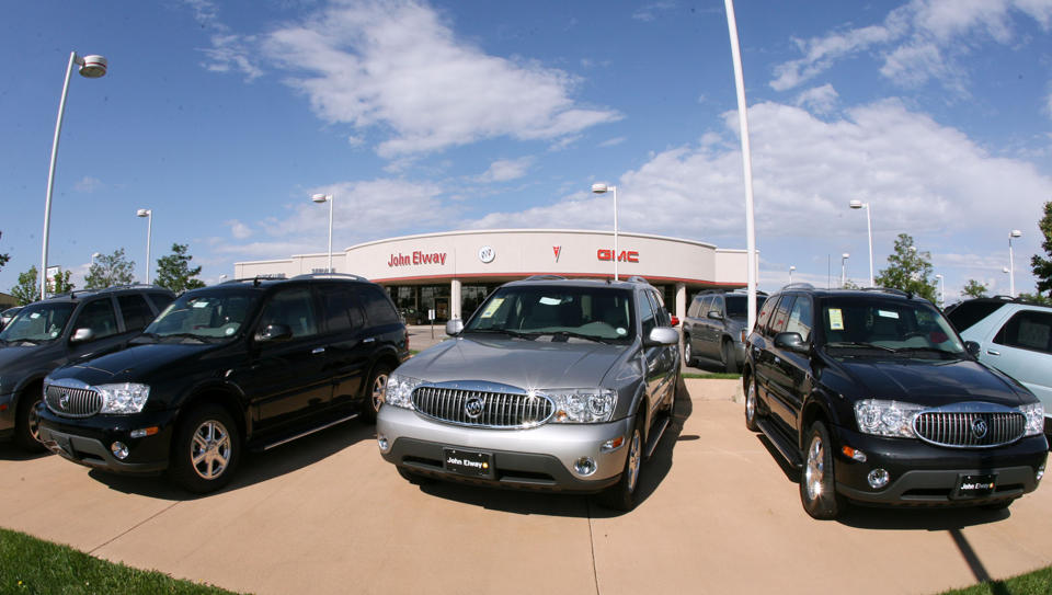 In this Aug. 27, 2006 file photo, a trio of unsold 2006 Buick Rainier sport-utility vehicles sits in front of a Buick dealership in the southeast Denver suburb of Lone Tree, Colo. (AP Photo/David Zalubowski, File)