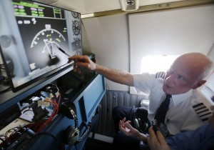Captain Bill Lusk of Southwest Airlines explains what the radar is showing to the media on a monitor during a Honeywell test flight that flew out of Dallas Love Field Airport in Dallas on Wednesday, August 13, 2014. Honeywell developed new technology that helps pilots spot bad weather and then, by showing them the storm in 3-D, helps them steer around it. (Vernon Bryant/The Dallas Morning News/MCT)