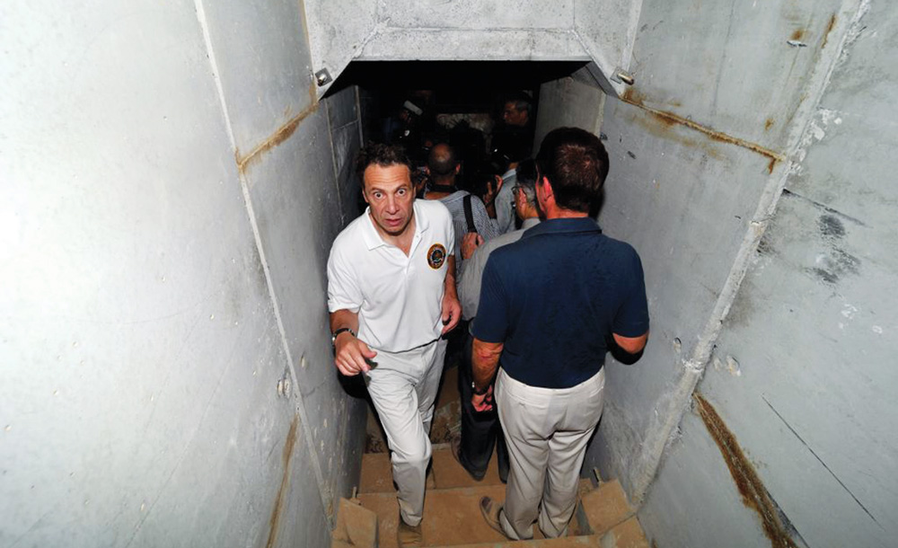 Gov. Andrew Cuomo on Thursday emerges from a tunnel in southern Israel dug by Hamas from Gaza.