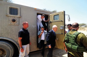 Cuomo jumps out of an Israeli armored personnel carrier near the Gaza border. Former president Shimon Peres is in the foreground.